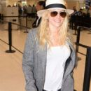 Katheryn Winnick at LMM airport in San Juan - 454 x 826