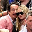 Mary-Kate Olsen and Olivier Sarkozy - 378 x 321