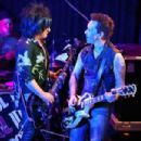 Musician Steve Stevens and Billy Morrison perform onstage for SiriusXM's Artist Confidential Series at The Troubadour on October 22, 2014 in Los Angeles, California