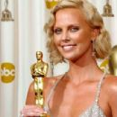 The 76th Annual Academy Awards: Charlize Theron pose with your Oscar statuette in 2004 - Press Room