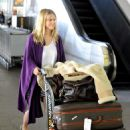Alice Eve Arrives Into LAX Airport On February 4, 2010