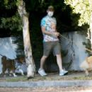 Aubrey Plaza – Out with Jeff Baena for a dogs walk in Los Angeles