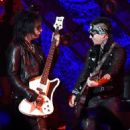 Nikki Sixx and DJ Ashba of Sixx:A.M. perform at The Joint inside the Hard Rock Hotel & Casino on April 10, 2015 in Las Vegas, Nevada