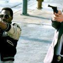 Eddie Murphy and Judge Reinhold in Beverly Hills Cop (1984)