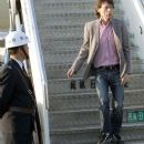 Mick Jagger walks out a plane as the Rolling Stones arrive at Shanghai Pudong International airport - 6 April 2006