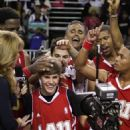 Justin Bieber plays at the 2011 BBVA NBA All-Star Celebrity Game at the Los Angeles Convention Center on February 18, 2011 in Los Angeles