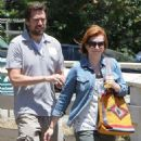 Couple Alyson Hannigan and Alexis Denisof spend some time together at a park in Brentwood, California on July 17, 2015 - 454 x 572