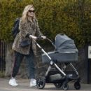 Laura Whitmore – With Iain Sterling out with their newborn baby in outin London - 454 x 413