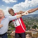 This picture shows Usain Bolt with Sir Richard Branson performing in one of his many adverts for Virgin Media - 454 x 306