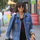 Nina Dobrev – Takes her dog Maverick for a walk in Hollywood