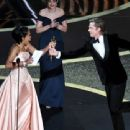 Regina King and Brad Pitt At The 92nd Annual Academy Awards - Show