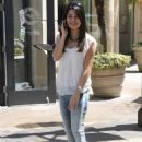 Miranda Cosgrove chats away on her phone while at The Grove in Los Angeles, California (July 16)