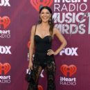 Jessica Szohr attends the 2019 iHeartRadio Music Awards which broadcasted live on FOX at Microsoft Theater on March 14, 2019 in Los Angeles, California - 400 x 600