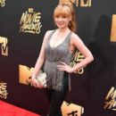 Actress Ashley Rickards attends the 2016 MTV Movie Awards at Warner Bros. Studios on April 9, 2016 in Burbank, California. MTV Movie Awards airs April 10, 2016 at 8pm ET/PT