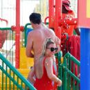 Billie Faiers in Red Swimsuit at a water park in Dubai - 454 x 861