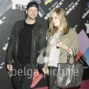 Nicolle Radzivil and Jamie Kennedy Arrive at the T-Mobile Party - 340 x 512