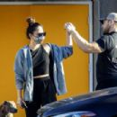 Olivia Munn – leaving a workout in Los Angeles