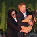 Musician Gene Simmons and actor Steven Bauer perform on stage during the Children Matter.NGO first annual gala on November 7, 2015 in Beverly Hills, California. - 454 x 303