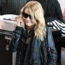 """Emilie De Ravin, Who Plays Claire On ABC's Hit TV Series """"Lost"""", Tries To Talk On Her Cell Phone While Passing Through Security At LAX. (March 2008)"""