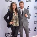 Steven Tyler and Dierks Bentley attend the 48th annual CMA Awards at the Bridgestone Arena on November 5, 2014 in Nashville, Tennessee. - 395 x 594