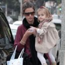 Alessandra Ambrosio carries her daughter Anja as she and her boyfriend Jaime Mazur walk down the street heading to Urth Cafe