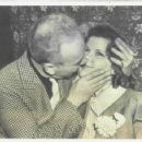 Tommy Manville, asbestos heir and rich playboy, here is shown as he last night kissed the blonde he has chosen for his fifth wife. His latest choice, Miss Nina Pierson of Duluth, now is a guest of Manville at the suburban New York estate