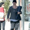 Colin Farrell and a friend out for a walk before heading to a yoga class in Los Angeles, California on December 27, 2013