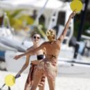 Candice Swanepoel was seen enjoying a relaxing final day in St Barths with some friends and fans on the beach on January 30, 2012