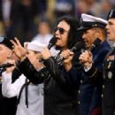 Gene Simmons sings the National Anthem before the game between the Atlanta Braves and the Los Angeles Dodgers at Dodger Stadium on May 08, 2019 in Los Angeles, California - 454 x 307
