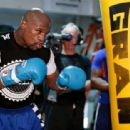 Floyd Mayweather Jr. (L) works out with Nate Jones at the Mayweather Boxing Club on September 2, 2014 in Las Vegas, Nevada - 454 x 312