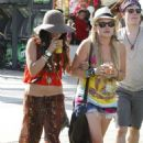 All dolled up like two hipster/ hippies actress Vanessa Hudgens & her new love Josh Hutcherson belly up to the bar to cool down with some afternoon spirits at Coachella Music Festival in Indio, CA on April 15.