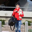Krysten Ritter with her dog at LAX Airport in LA - 454 x 664