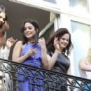 Selena Gomez, Vanessa Hudgens, Rachel Korine, and Ashley Benson waving to their fans from their balcony at Bristol hotel in Paris, France, on February 17th 2013 - 454 x 273