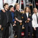 Metallica pose in the press room during the 24th Annual Rock and Roll Hall of Fame Induction Ceremony at Public Hall on April 4, 2009 in Cleveland, Ohio - 454 x 313