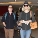 Leslie Bibb and Sam Rockwell departing on a flight at LAX airport in Los Angeles, California on January 26, 2015. The pair were all smiles as they made their way through the airport - 454 x 535