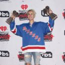 "Justin Bieber, winner of the awards for Best Male Artist and Dance Song of the Year ('Where Are U Now""), poses in the press room during the iHeartRadio Music Awards at The Forum on April 3, 2016 in Inglewood, California"