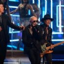 Singer Robin Thicke, musician Joe Perry and rapper Pitbull perform onstage during The 58th GRAMMY Awards at Staples Center on February 15, 2016 in Los Angeles, California.