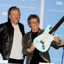 Robert Plant and Roger Daltrey pose at a press conference to announce the Daltrey/Townsend Teen & Young Adult Cancer Program at UCLA on November 4, 2011 in Los Angeles, California - 454 x 308