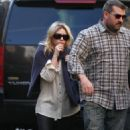 Ashley Olsen hides behind a bodyguard as she gets out of a town car in the West Village-April.1