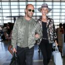 Hats off to her! Fedora-sporting Rosie Huntington-Whiteley covers her supermodel figure in quirky printed jacket as she steps out with boyfriend Jason Statham