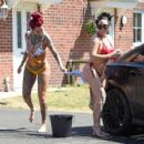Jemma Lucy and Laura Alicia Summers in Bikini – Car Washing in Manchester - 454 x 428