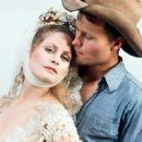 Beverly D'Angelo and John Savage