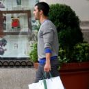 Joe Jonas leaving a NYC apartment building with shopping bags. (September 3)