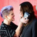 TV personality Kelly Osbourne (L) and musician Ozzy Osbourne attend the MusiCares MAP Fund Benefit Concert at Club Nokia on May 12, 2014 in Los Angeles, California