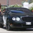 Cindy Crawford stops at a gas station to fill up her Bentley in Malibu, California on August 12, 2013