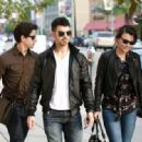 Joe Jonas chaperones his younger brother Nick and girlfriend Samantha Barks on a lunch date at Kings Road Cafe. January 07, 2011