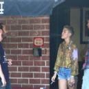 Miley Cyrus smokes a cigarette at a recording studio