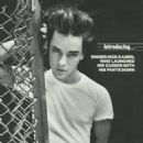 Nick Kamen Poses in Artsy Photo/Fence