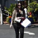 Michelle Trachtenberg in a leopard print jacket at Fred Segal in LA