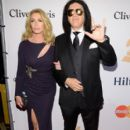 Actress/model Shannon Tweed and recording artist Gene Simmons attend the 2016 Pre-GRAMMY Gala and Salute to Industry Icons honoring Irving Azoff at The Beverly Hilton Hotel on February 14, 2016 in Beverly Hills, California.